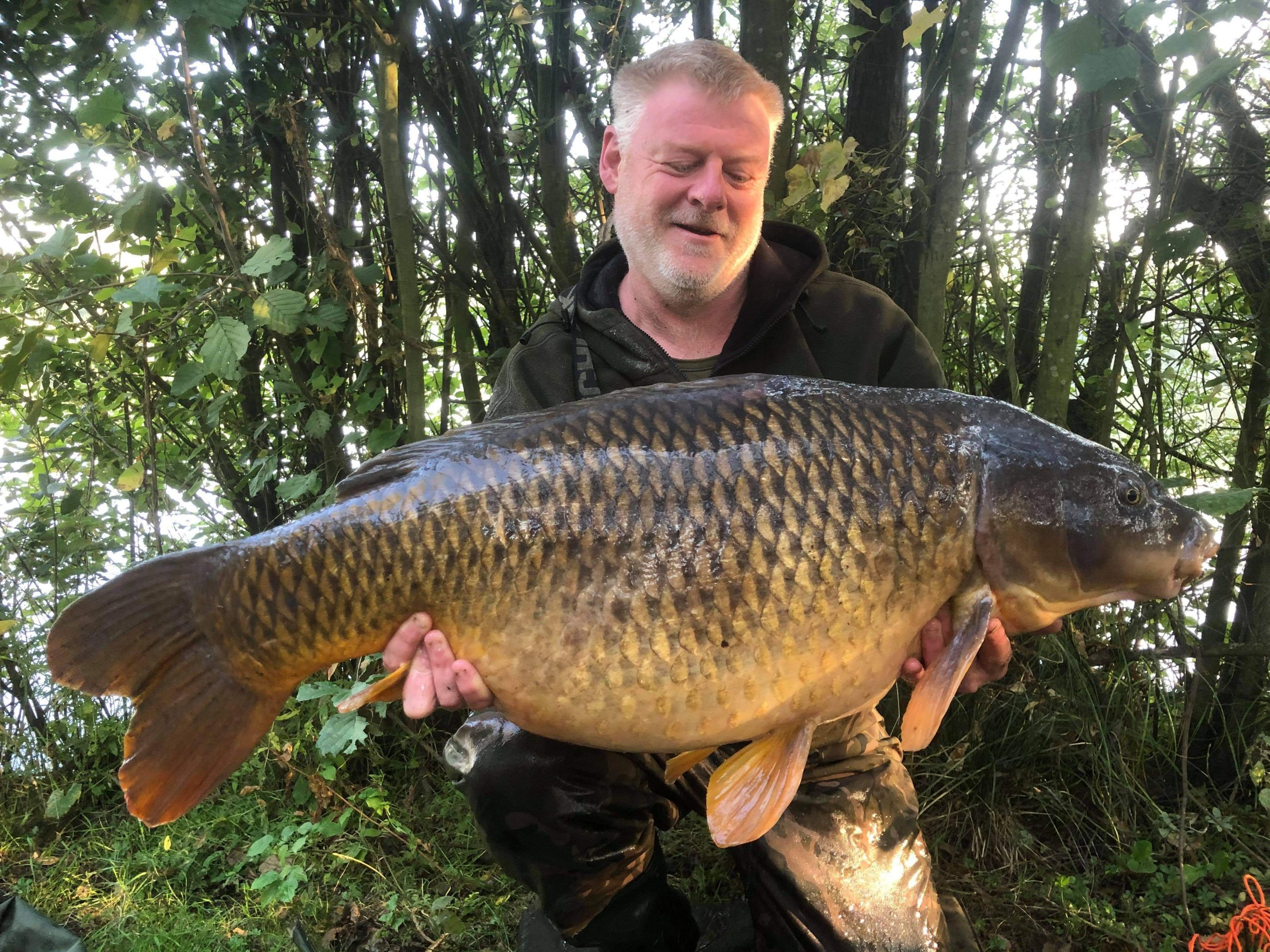 Spike with his new UK PB common caught on Whitetiger products.